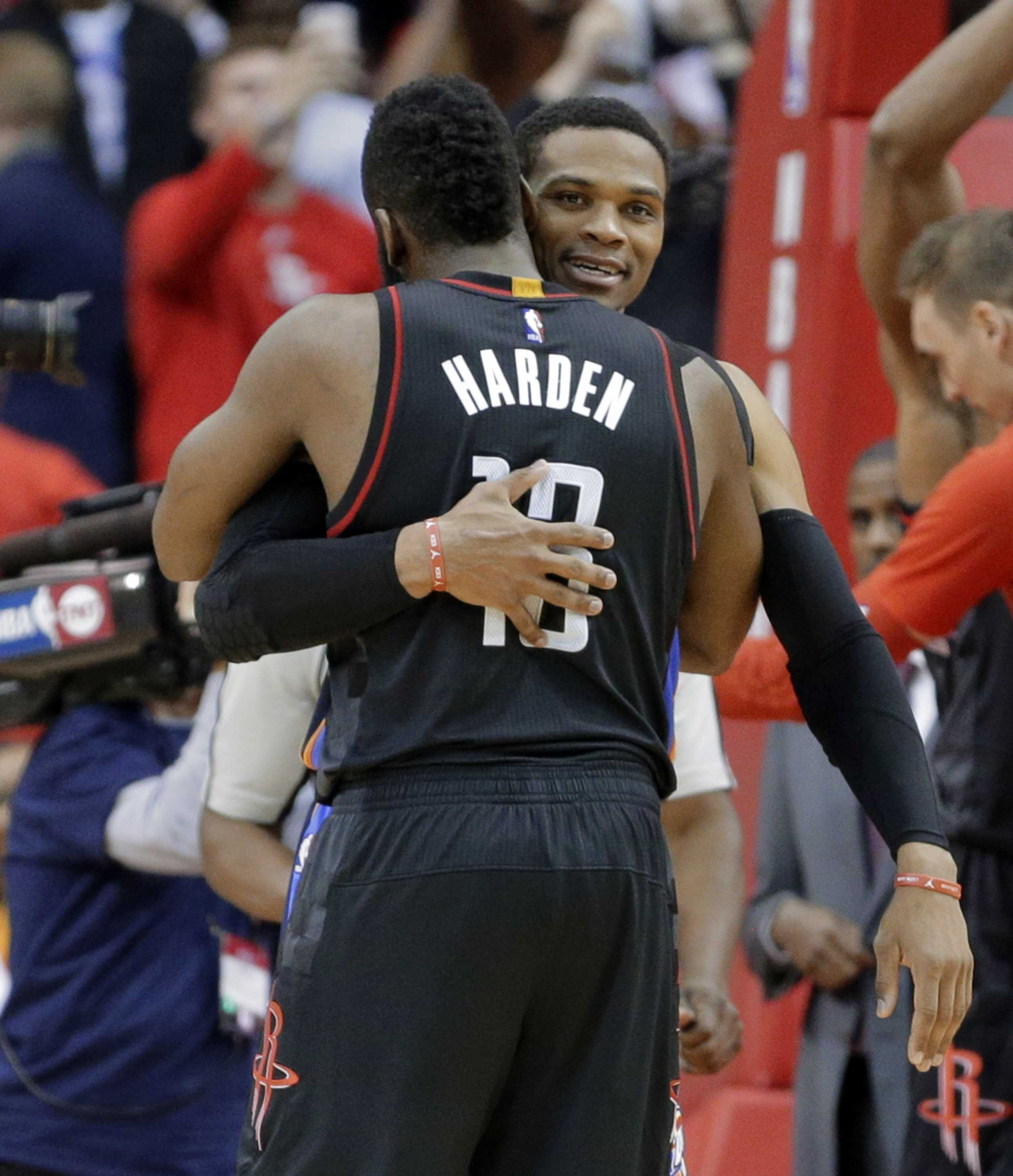 Houston Rockets' James Harden (13) hugs his former teammate, Oklahoma City Thunder's Russell Westbrook after an NBA basketball game in Houston, Thursday Jan. 5, 2017. The Rockets defeated the Thunder 118-116. (AP Photo/Michael Wyke)