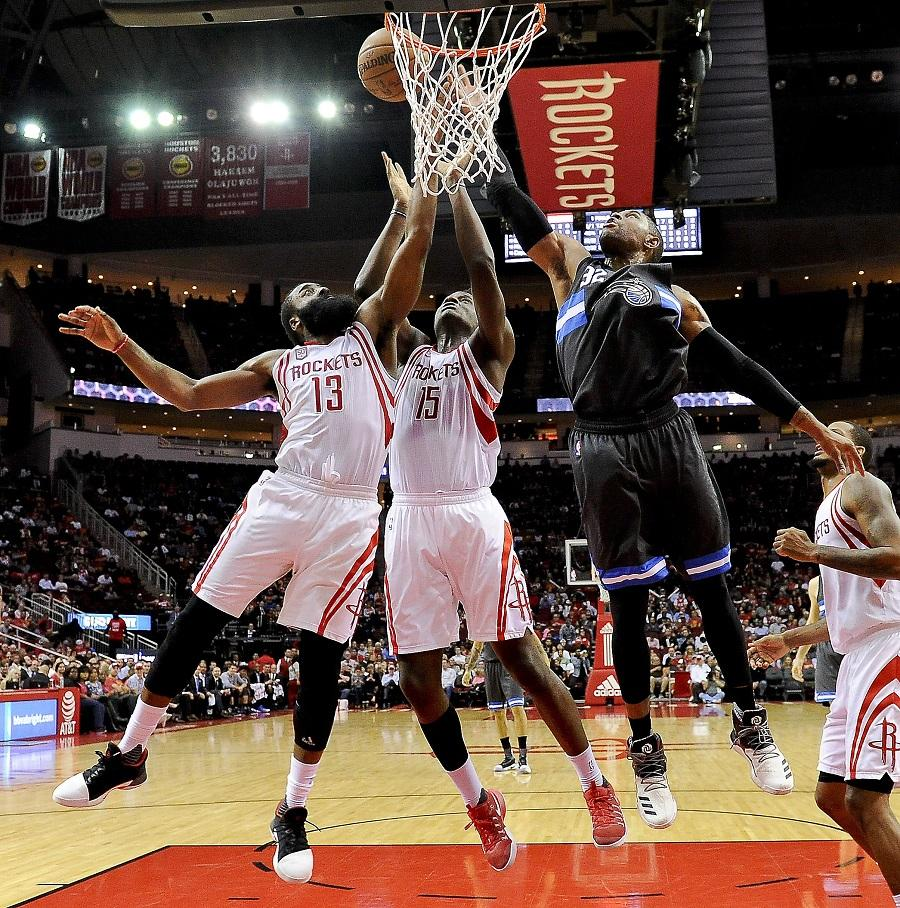 Houston Rockets guard James Harden (13), center Clint Capela (15) and Orlando Magic guard C.J. Watson (32) fight for a rebound in the second half of an NBA basketball game, Tuesday, Feb. 7, 2017, in Houston. Houston won the game 128-104. (AP Photo/Eric Christian Smith)