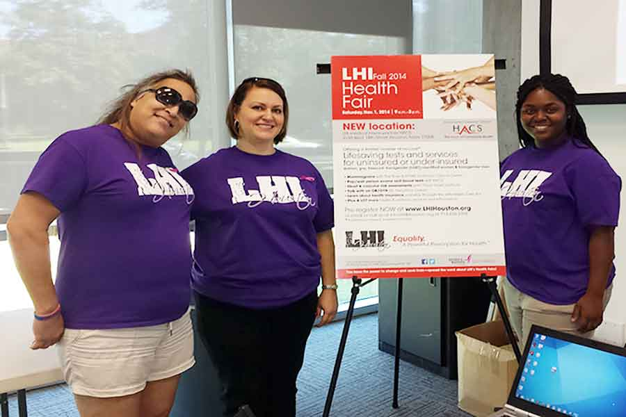 From left to right Rachel Alaniz, Juanita Valdes and Aurora Harris volunteers for LHI at the Coming Out Day hosted by OUTSA.