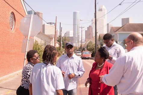 Congresswoman Lee, Bishop Dixon, Pastor Brown, and Charonda Johnson planning community picnic.