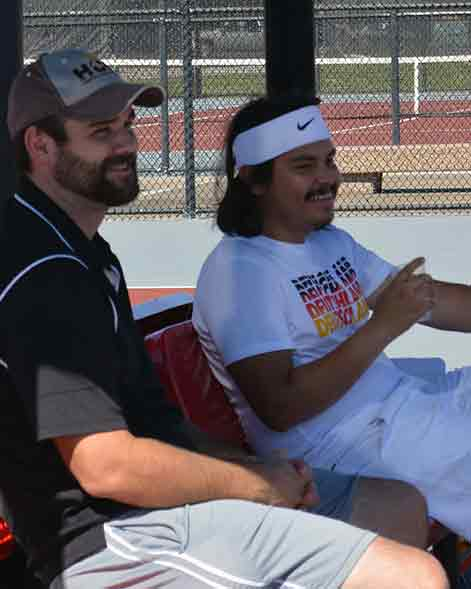 Coach Abernathy and Daniel Campos enjoy the beautiful weather and cheering on the team.