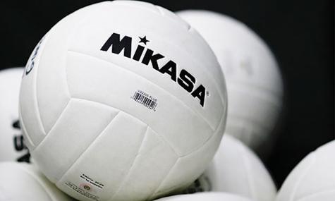 Bin of volleyballs.