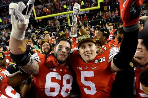 Ohio State's Taylor Decker (68) and Jeff Heuerman celebrate after the NCAA college football playoff championship game against Oregon Monday in Arlington, Texas. Ohio State won 42-20.