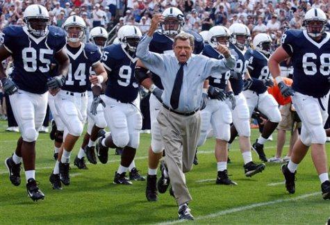 Penn State coach Joe Paterno leads his team onto the field.
