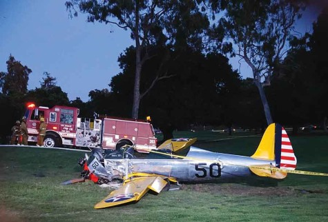 A vintage airplane that crash-landed on the Penmar Golf Course lies on the ground in the Venice area of Los Angeles, Thursday, March. Harrison Ford crash-landed the airplane shortly after taking off from a nearby airport and reporting engine problems.