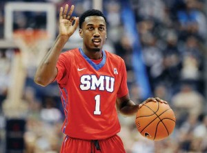 SMU's Ryan Manuel gestures during the second half of an NCAA college basketball game against Connecticut, in Hartford, Conn. Ryan and Simone Manuel were always close. They still talk just about every day, even though they attend college in different parts of the country.
