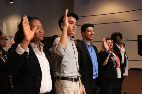 Here, some of Omega Sigma newest members take their membership pledge at the honor society's induction ceremony on Friday April 10.  Omega Sigma is HCC's chapter of Phi Theta Kappa.