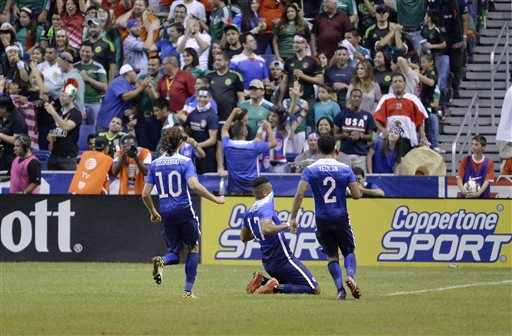 USA forward Juan Agudelo (17) celebrates a goal with teammates Mix Diskerud (10) and DeAndre Yedlin during the second half of an international friendly soccer match against Mexico, Wednesday, April 15, 2015, in San Antonio. United States won 2-0.