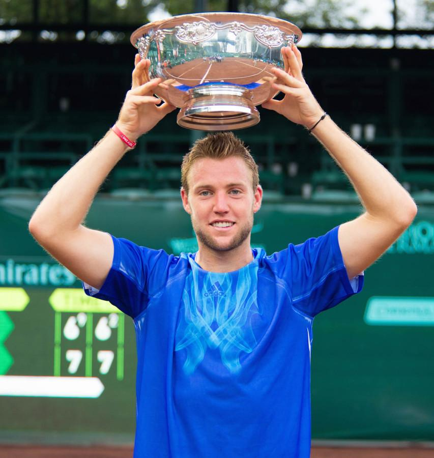 Raising+of+the+trophy+after+his+first+career+singles+victory.