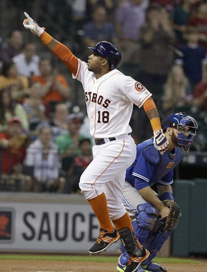 Houston+Astros%27+Luis+Valbuena+%2818%29+points+to+the+stands+as+he+crosses+home+plate+to+score+on+a+solo+homerun+beside+Toronto+Blue+Jays+catcher+Russell+Martin+in+the+first+inning+of+a+baseball+game%2C+Sunday%2C+May+17%2C+2015%2C+in+Houston.