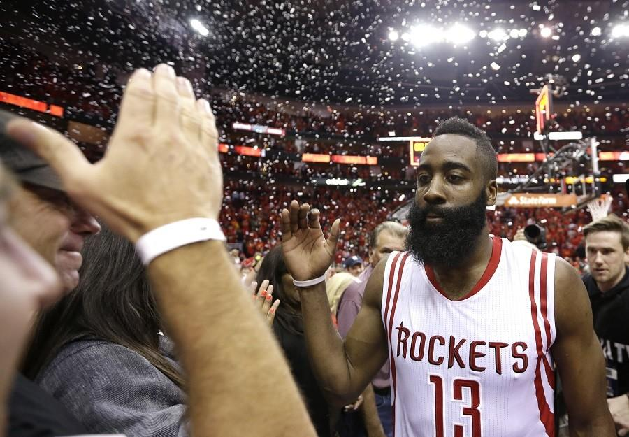 Houston+Rockets%27+James+Harden+%2813%29+celebrates+after+defeating+the+Los+Angeles+Clippers+113-100+in+Game+7+of+the+NBA+basketball+Western+Conference+semifinals%2C+Sunday%2C+May+17%2C+2015%2C+in+Houston.+