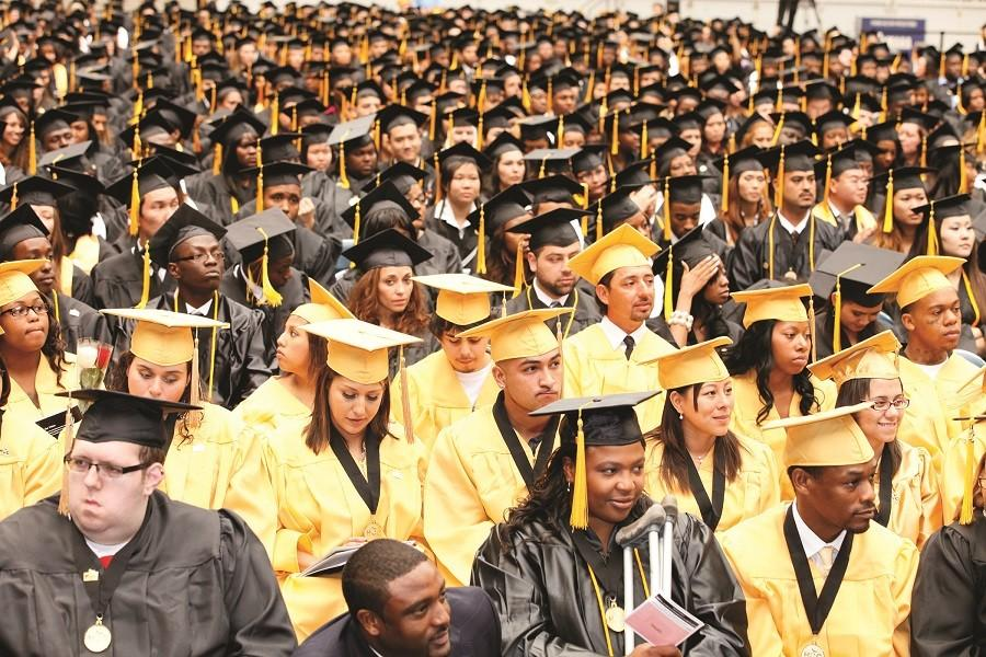 Students+await+their+name+being+called+during+the+2011+graduation+ceremony.+This+year%27s+graduation+is+schedule+for+Saturday%2C+May+16+at+NRG+Stadium.+