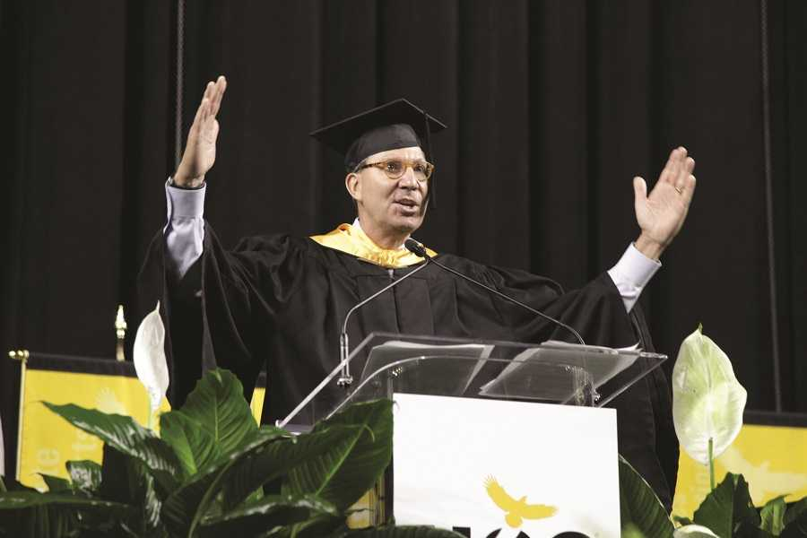 H-E-B Houston Division President Scott McClelland speaks to Houston Community College graduates during the school's graduation ceremony Saturday at NRG stadium.