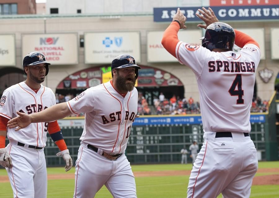 Houston+Astros+designated+hitter+Evan+Gattis+%2811%29+celebrates+his+three-run+home+run+against+the+Seattle+Mariners+with+teammate+George+Springer+%284%29+in+the+first+inning+of+a+baseball+game+on+Sunday%2C+May+3%2C+in+Houston.