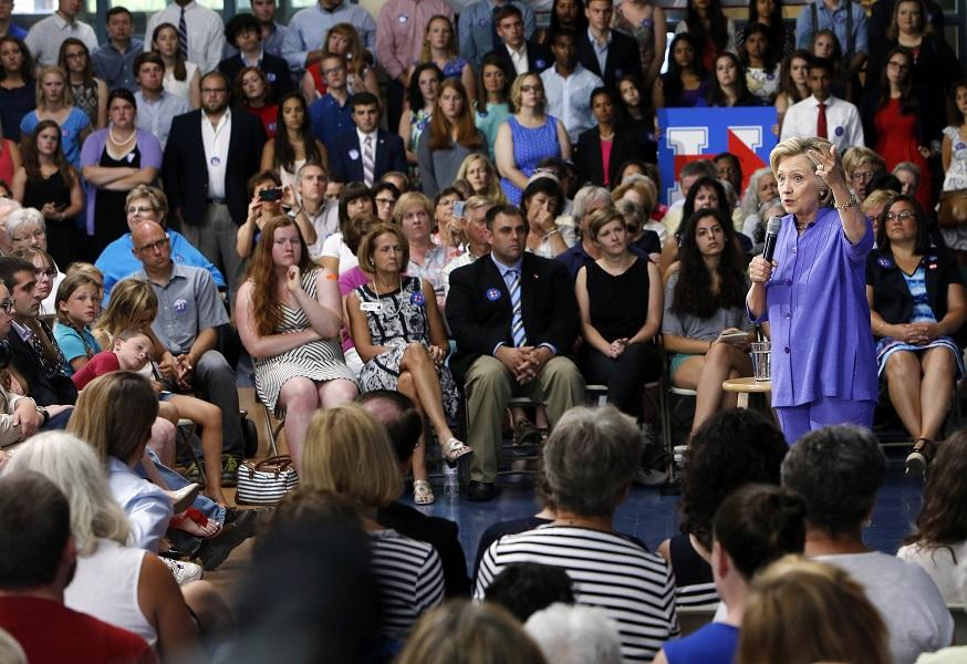 Democratic presidential candidate Hillary Rodham Clinton answers questions after announcing her college affordability plan, Monday, Aug. 10, at the high school  in Exeter, N.H.