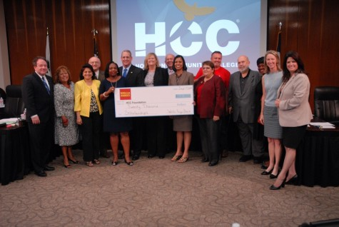 Wells Fargo gave $20 thousand to the HCC Foundation, presenting the check on Sept 17 at the Board of Trustees meeting. Pictured here are Wells Fargo representatives with members of the HCC board of trustees, HCC Chancellor Cesar Maldonado and representatives of the HCC Foundation scholarship fund.