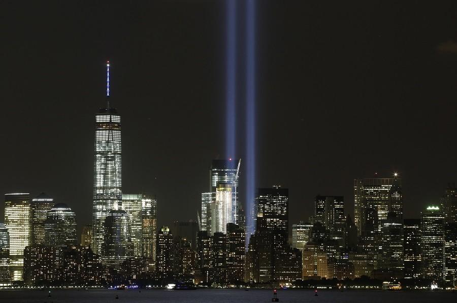The Tribute in Light rises above the New York skyline and One World Trade Center, left, Friday, Sept. 11, 2015, in a view from Bayonne, N.J. It was the 14th anniversary of the Sept. 11 terror attacks on Friday.