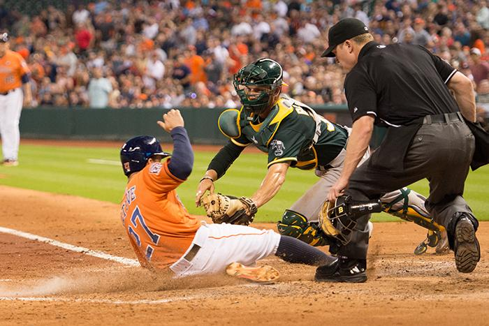 Jose+Altuve+beeting+the+throw+home+in+the+3rd+inning+of+game+1+of+the+series.