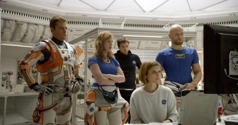 """In this photo provided by Twentieth Century Fox, Matt Damon, from left, as Astronaut Mark Watney, Jessica Chastain as Melissa Lewis, Sebastian Stan as Chris Beck, Kate Mara as Beth Johanssen, and Aksel Hennie as Alex Vogel, appear in a scene in the film, """"The Martian."""" The movie releases in U.S. theaters on Oct. 2, 2015."""