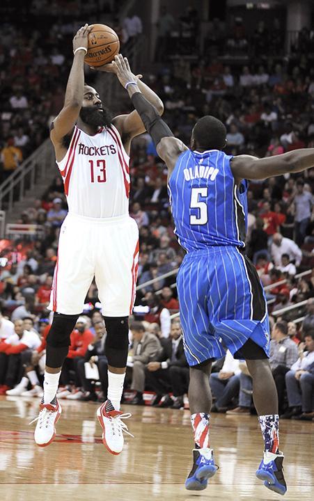 Houston Rockets' James Harden (13) shoots over Orlando Magic's Victor Oladipo (5)