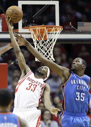 Oklahoma City Thunder's Kevin Durant (35) tries to block a shot by Houston Rockets' Corey Brewer (33).