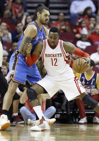 Houston Rockets' Dwight Howard (12) pushes against Oklahoma City Thunder's Steven Adams in the first half of an NBA basketball game Monday, Nov. 2, 2015, in Houston.