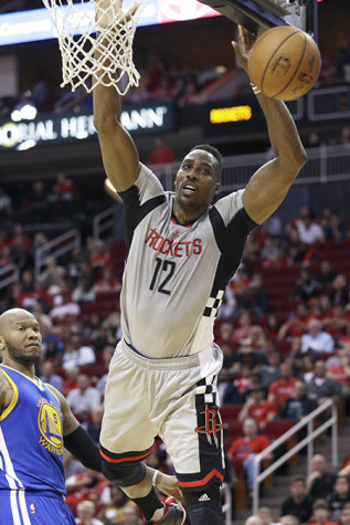 Houston Rockets' Dwight Howard (12) loses the ball as Golden State Warriors' Marreese Speights (5) looks on in the second half.