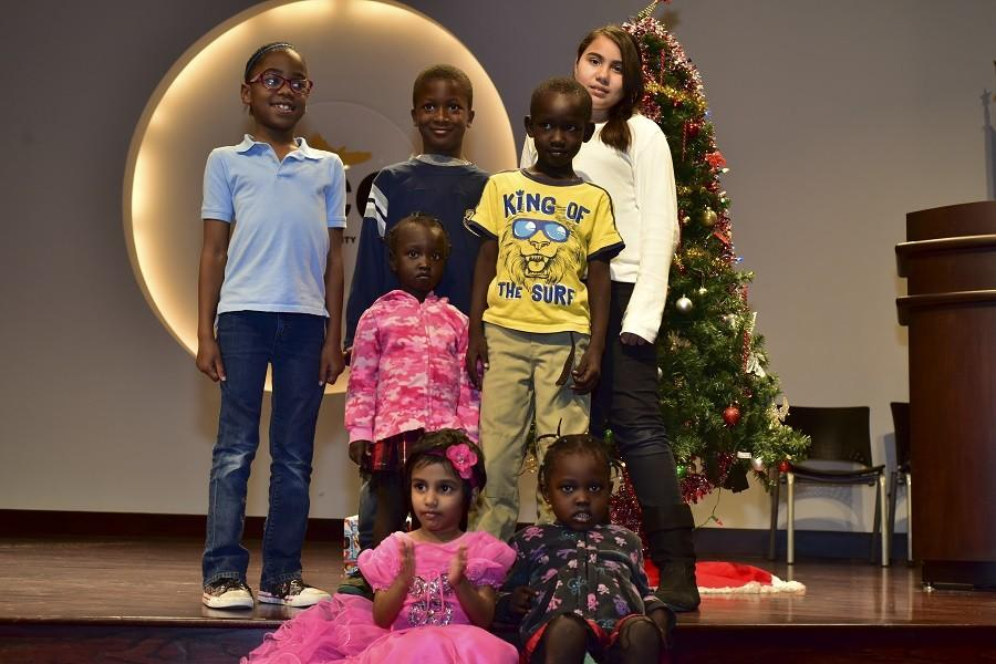 These children received a very merry Christmas from Sgt. R. Johnson and Officers F. Carter and K. Davis at their Christmas Dec. 15 at the West Loop campus.