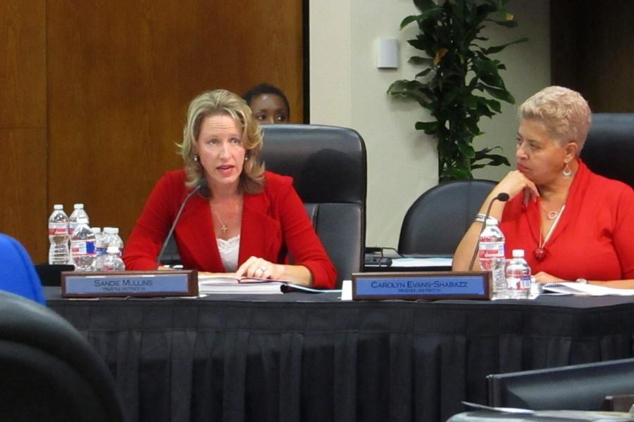 Outgoing District VI Trustee Sandie Mullins makes her farewell remarks at the board meeting Thursday Dec. 17. Right is District IV Trustee Dr. Carolyn Evans-Shabazz.