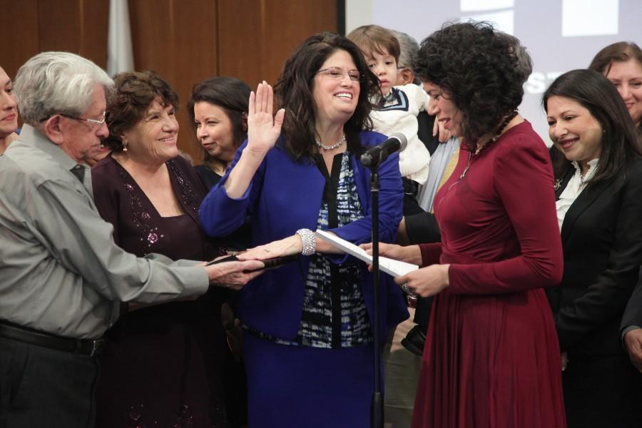 Surrounded by friends and family, Dr. Adriana Tamez takes the oath of office, marking the start of her second term as HCC District III Trustee, and Board Chair for 2016. Texas State Representative Carol Alvarado of district 145 administered the oath of office for Tamez.