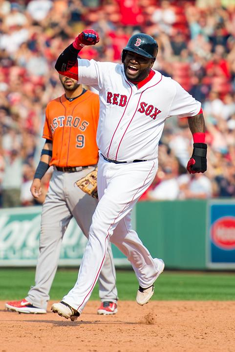 David Ortiz trots around the bases after blasting a homerun at Fenway Park on July 5, 2015