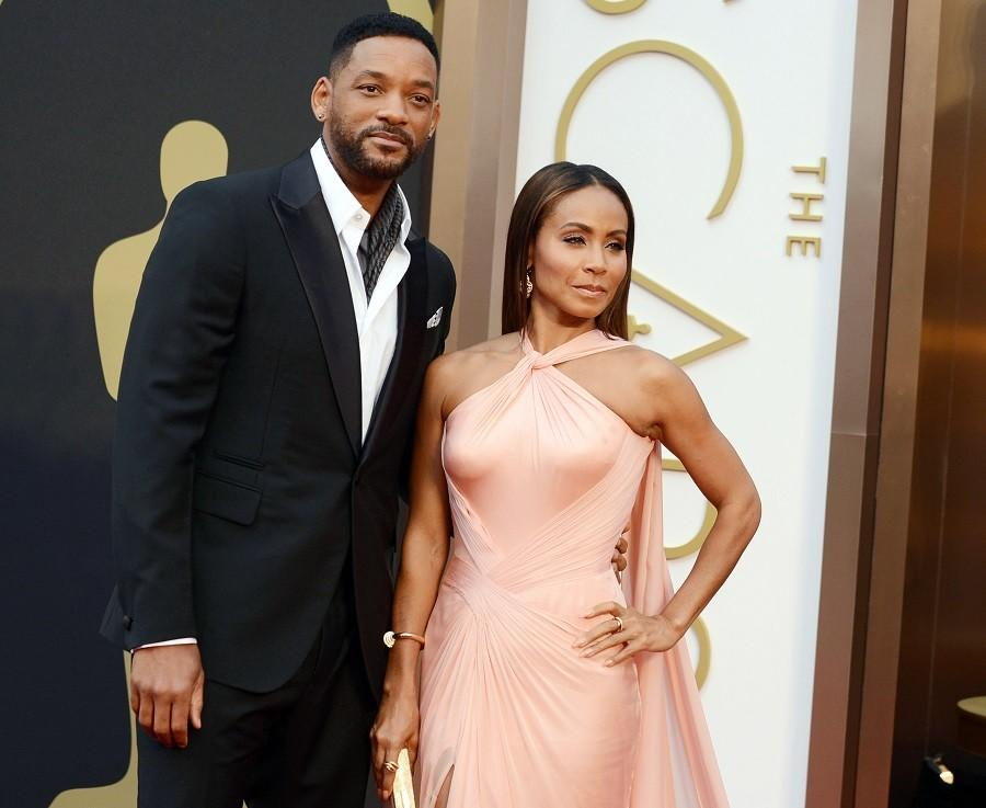 In this March 2, 2014, photo, Will Smith, left, and Jada Pinkett Smith arrive at the Oscars at the Dolby Theatre in Los Angeles. Smith said Thursday, Jan. 21, he will not attend the Academy Awards next month, joining his wife, Jada Pinkett Smith, and others in protest against two straight years of all-white acting nominees. (Photo by Jordan Strauss/Invision/AP, File)