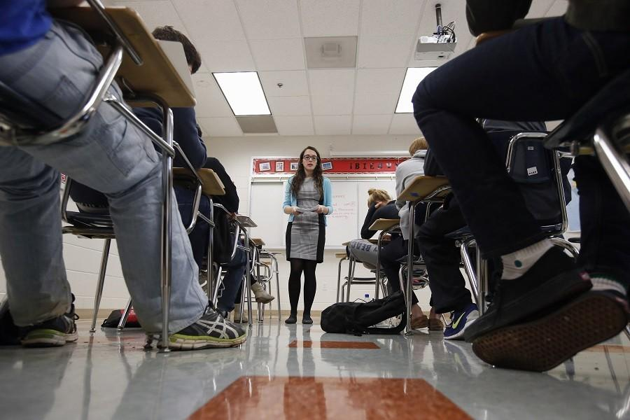 Katerina Maylock, with Capital Educators, teaches a college test preparation class at Holton Arms School in Bethesda. (AP Photo/Alex Brandon)