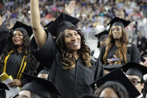 An HCC graduate in a moment of celebration during the commencement ceremony, May 2015.