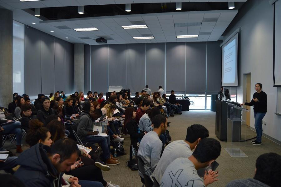 Speaker informing new students at advising and registration orientation at Houston Community College Central campus.