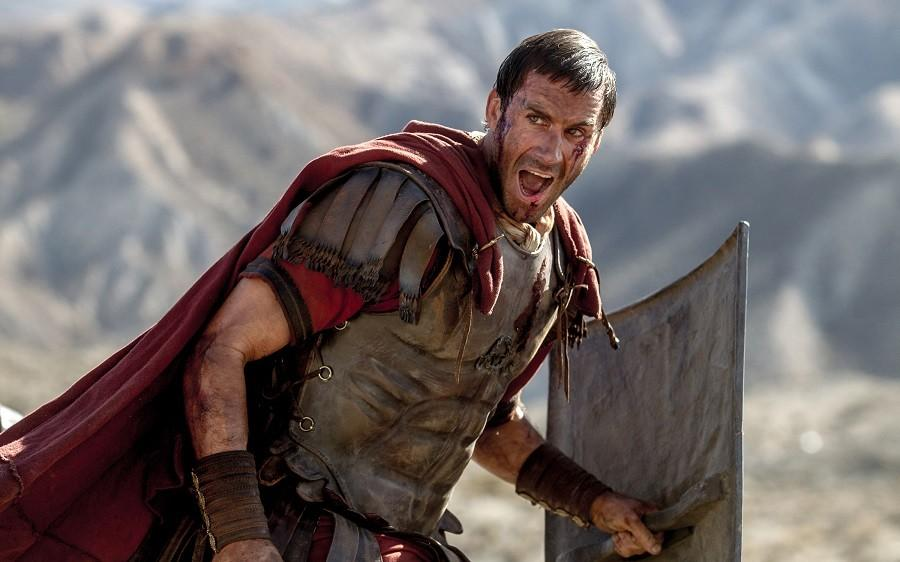 In this image provided by Columbia Pictures, Joseph Fiennes as Clavius leads his Roman soldiers during the zealot battle in Columbia Pictures'