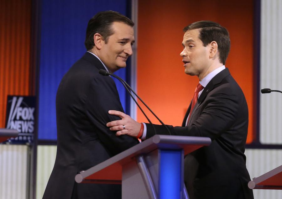 Ted Cruz and Marco Rubio talk after a Republican presidential primary debate, Thursday, Jan. 28, in Des Moines, Iowa. (AP Photo/Chris Carlson)