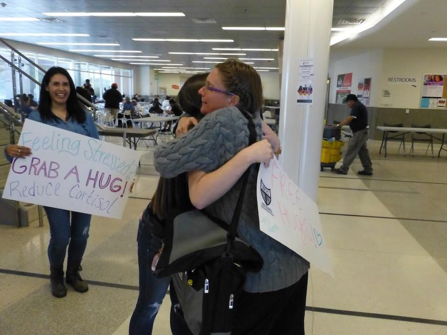 Students give free hugs