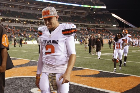 In this Nov. 5, 2015, file photo, Cleveland Browns quarterback Johnny Manziel walks off the field after the Browns lost 31-10 to the Cincinnati Bengals during an NFL football game in Cincinnati. The Browns said Tuesday, Feb. 9, 2016, that Manziel was diagnosed with a concussion late in the season by an independent neurologist, countering an NFL Network report they lied about the injury to cover up the troubled quarterback showing up intoxicated for practice.