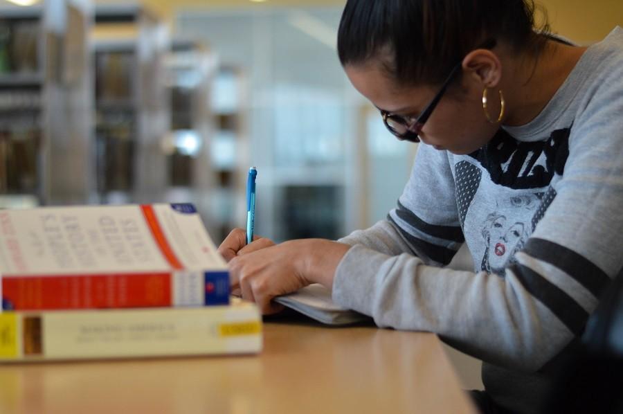 Teniqua Williams studies in the HCC Central library.
