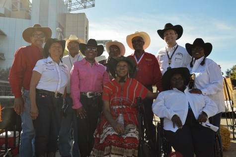 African-American cowboys pose during Black Heritage Day at the Houston Rodeo along with Rodeo President Joel Cowley.