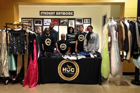 Members of Houston Community College's Southwest Student Government Association pose for a photo with the prom clothes collected from HCC students for Mia's Closet. The clothes will help underprivileged youth afford their prom.