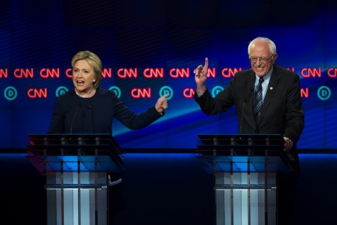 Democratic presidential candidates Hillary Clinton, left, and, Sen. Bernie Sanders, I-Vt., argue a point during a Democratic presidential primary debate at the University of Michigan-Flint, Sunday, March 6, 2016, in Flint, Mich.