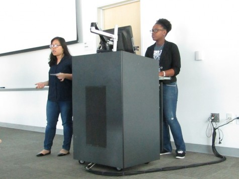 Central Student Library Advisory Council Secretary Thao Nguyen (left) and Treasurer Jessica White (right) address the Faculty Senate meeting on March 11 to ask instructors to use free, open sourced textbooks like OpenStaxs.