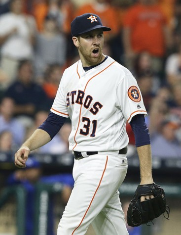 Houston Astros starting pitcher Collin McHugh yells as he heads to the dugout at the end of the top of the seventh inning against the Kansas City Royals in a baseball game Monday, April 11, 2016, in Houston.