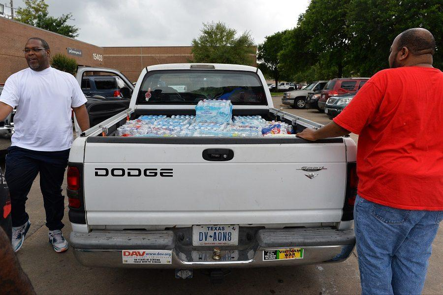 Jaye Delai delivers a truckload of bottled water collected from Third Ward residents to give to flood victims.