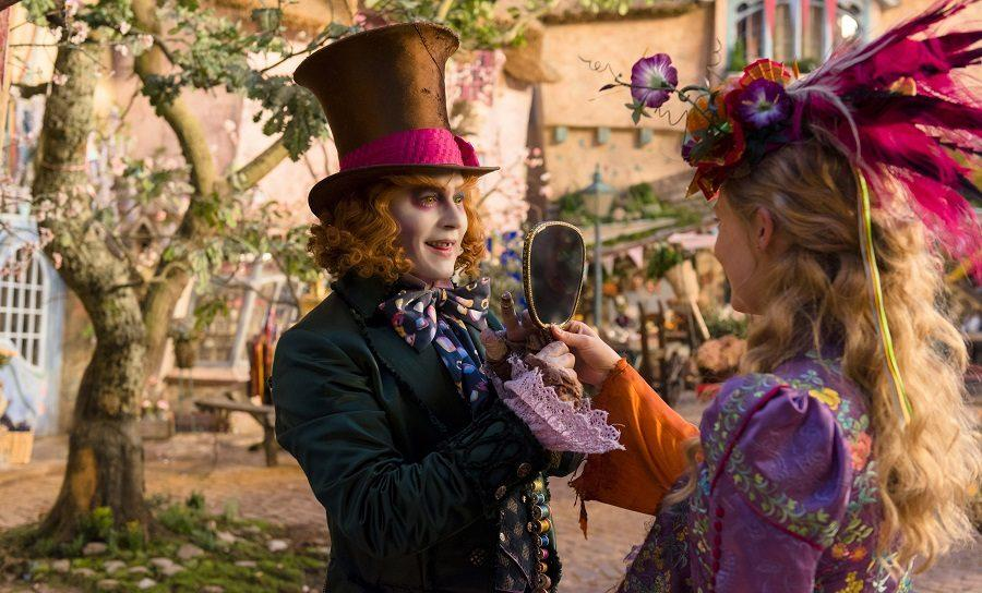 In this image released by Disney, Johnny Depp, left, and Mia Wasikowska appear in a scene from