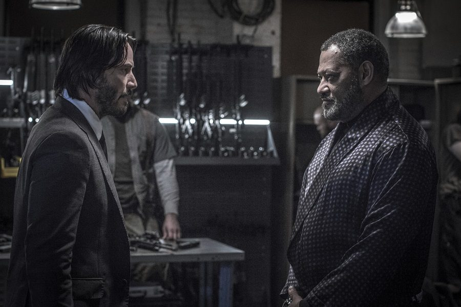 This image released by Lionsgate shows Keanu Reeves, left, and Laurence Fishburne in a scene from,