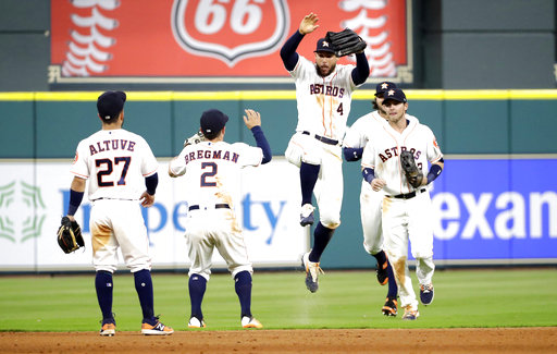 Houston Astros' George Springer (4) celebrates with Alex Bregman (2) after defeating the Los Angeles Angels 3-0. (AP Photo/David J. Phillip)