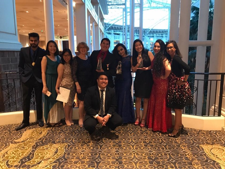 HCCs Phi Theta Kappa - Omega Sigma chapter officers and advisers poise with their international distinguished chapter and project awards at the Catalyst convention in Nashville, Tennessee.